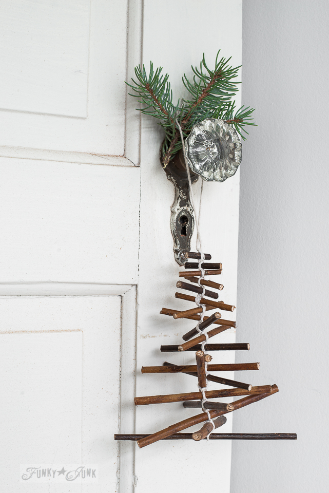 Rustic twig Christmas tree ornament hanging from a vintage glass doorknob / funkyjunkinteriors.net