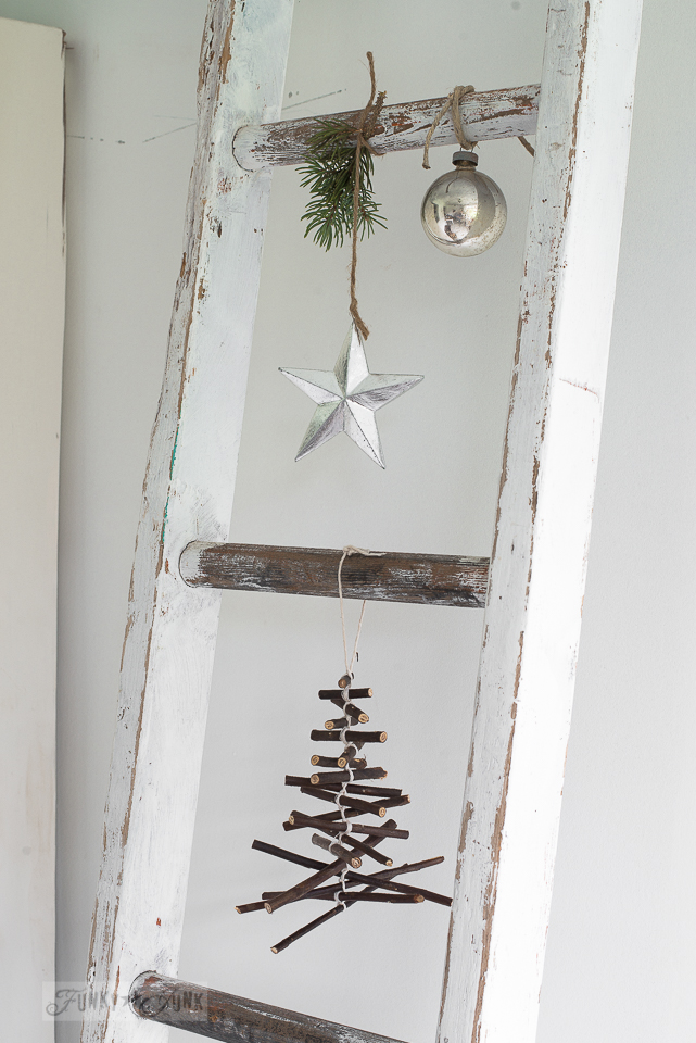 rustic twig Christmas tree ornament hanging from a ladder / funkyjunkinteriors.net