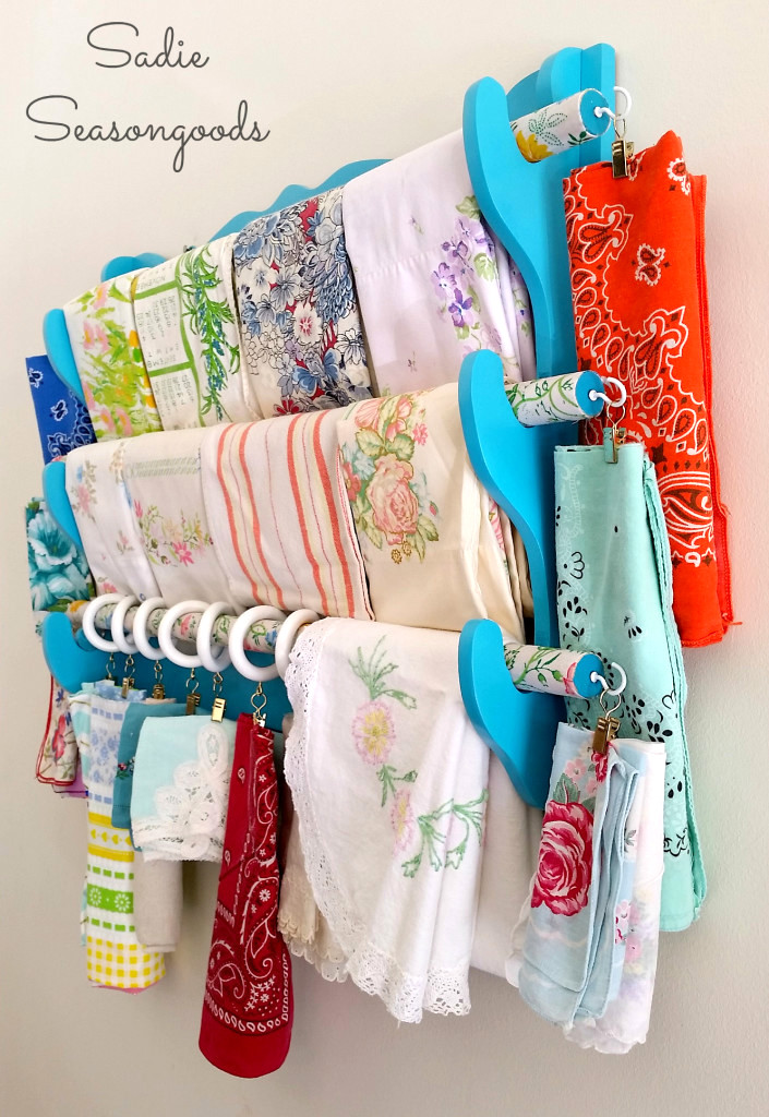 Gun rack turned fabric organizer by Sadie Seasongoods, featured on Funky Junk Interiors