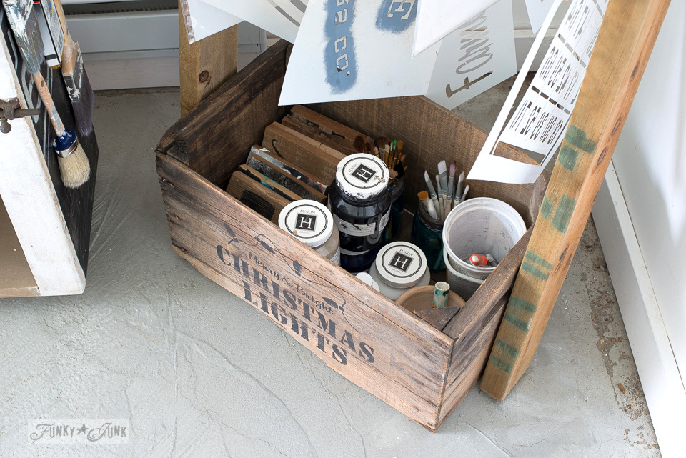 storing paint supplies in an old crate / The making a DIY ladder stencil organizer : funkyjunkinteriors.net