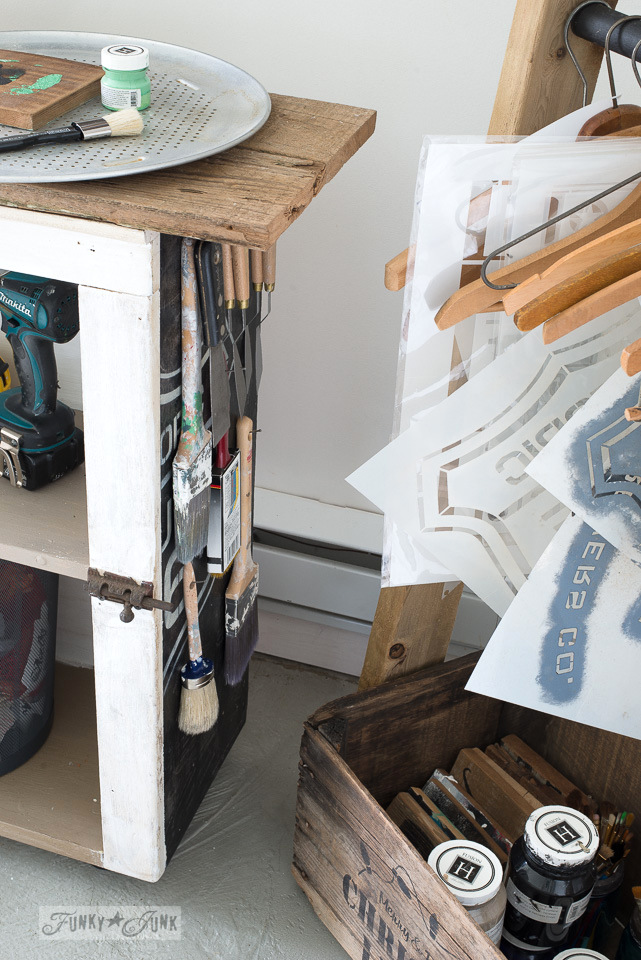 cupboard side loaded with paint brush storage / The making a DIY ladder stencil organizer : funkyjunkinteriors.net