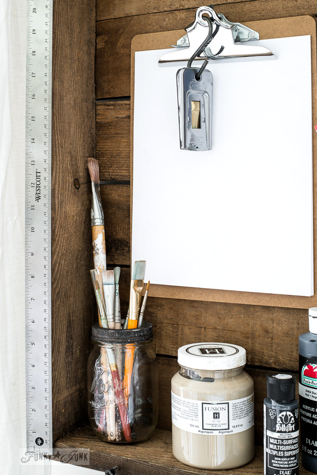 an old table top turned into a storage wall shelf / The making a DIY ladder stencil organizer : funkyjunkinteriors.net