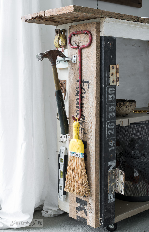 cupboard side loaded with tool storage / The making a DIY ladder stencil organizer : funkyjunkinteriors.net