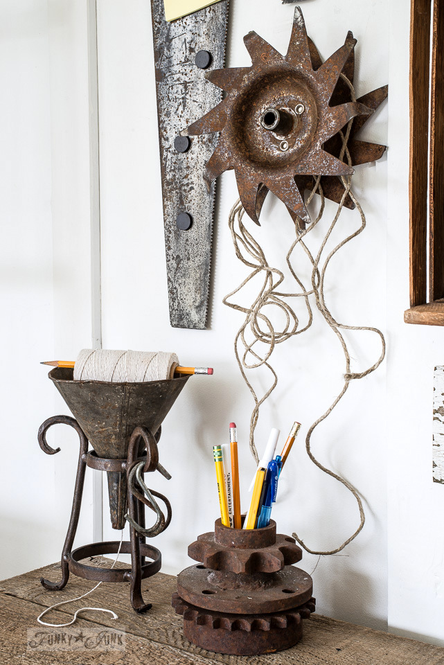 Cultivator wheel and funnel to hold twine / A rusty tool themed work station / funkyjunkinteriors.net