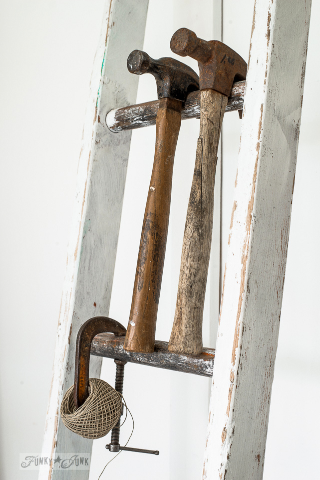 Hammer on a ladder organizer / A rusty tool themed work station for organizing tools and office gear / funkyjunkinteriors.net