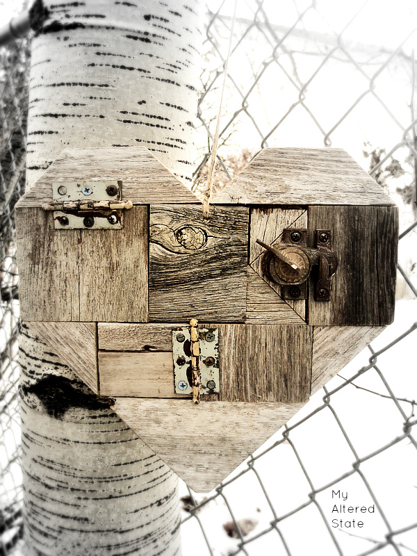 DIY scrap wood heart with rusty locks, by My Altered State, featured on Funky Junk Interiors