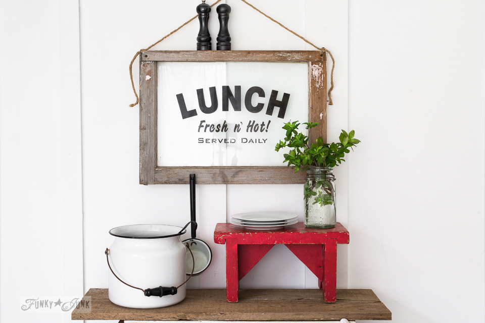 Learn how to stencil on glass with this charming LUNCH sign on an old window! Click to full tutorial.