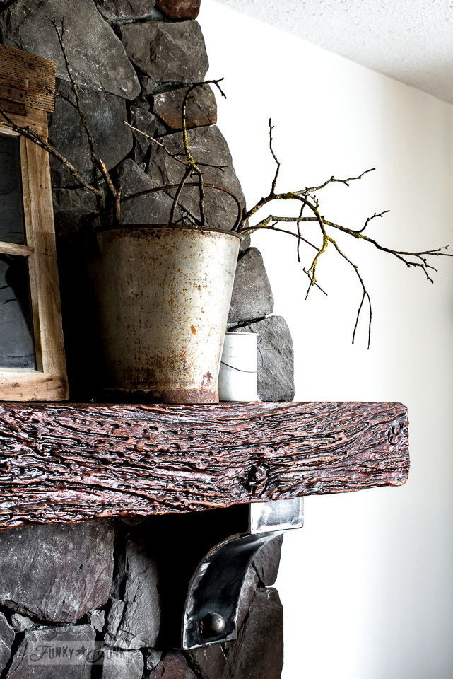 Moody winter mantel, with branches, antlers an old window and galvanized buckets / funkyjunkinteriors.net