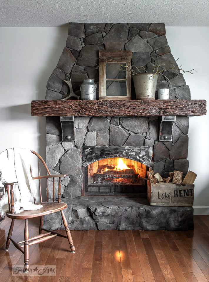 tone on tone decorating, with a moody winter mantel of branches, antlers an old window and galvanized buckets / funkyjunkinteriors.net