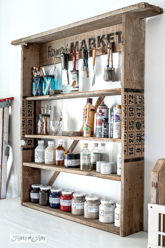 Rustic reclaimed wood paint shelf storing Fusion Mineral Paint and brushes, made with Old Sign Stencils | funkyjunkinteriors.net
