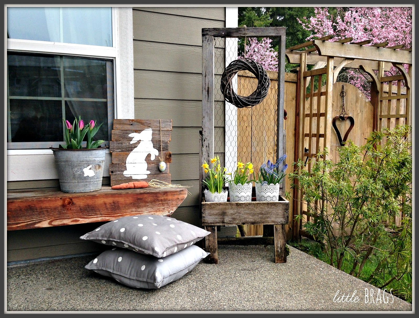 Easter spring themed porch decorating, by Little Brags, featured on Funky Junk Interiors