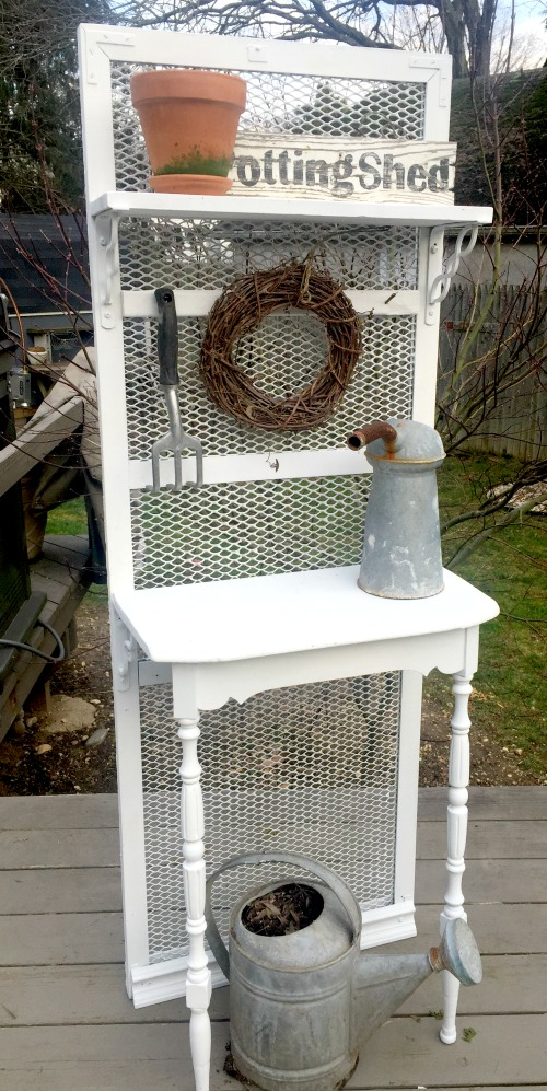 A DIY POTTING BENCH FROM A METAL GRATE, by Homeroad, featured on Funky Junk Interiors