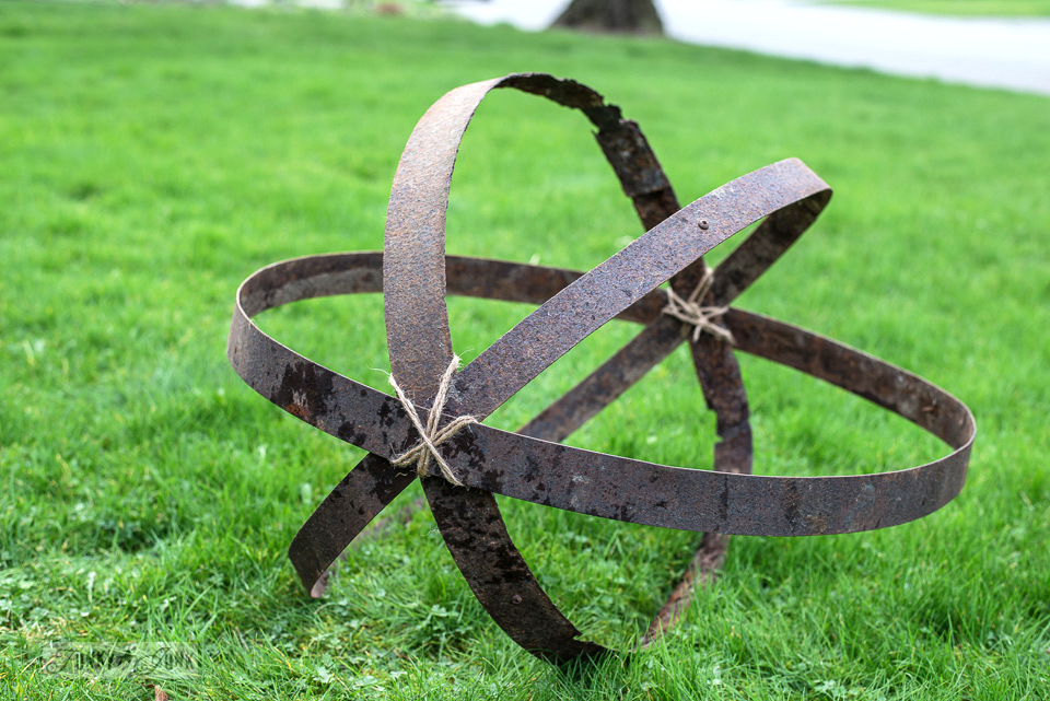 Learn how to make this rusty junk garden orb from broken barrel rings! #gardenart