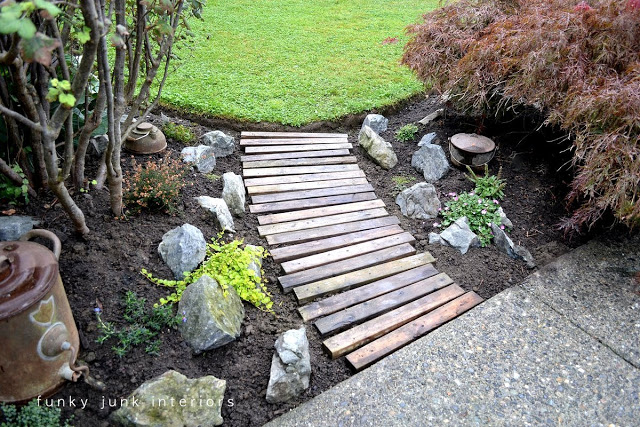 Learn how to build this easy and beautiful garden reclaimed wood walkway with scrap wood! Click for full tutorial and short video! #gardening #walkway #reclaimed #wood