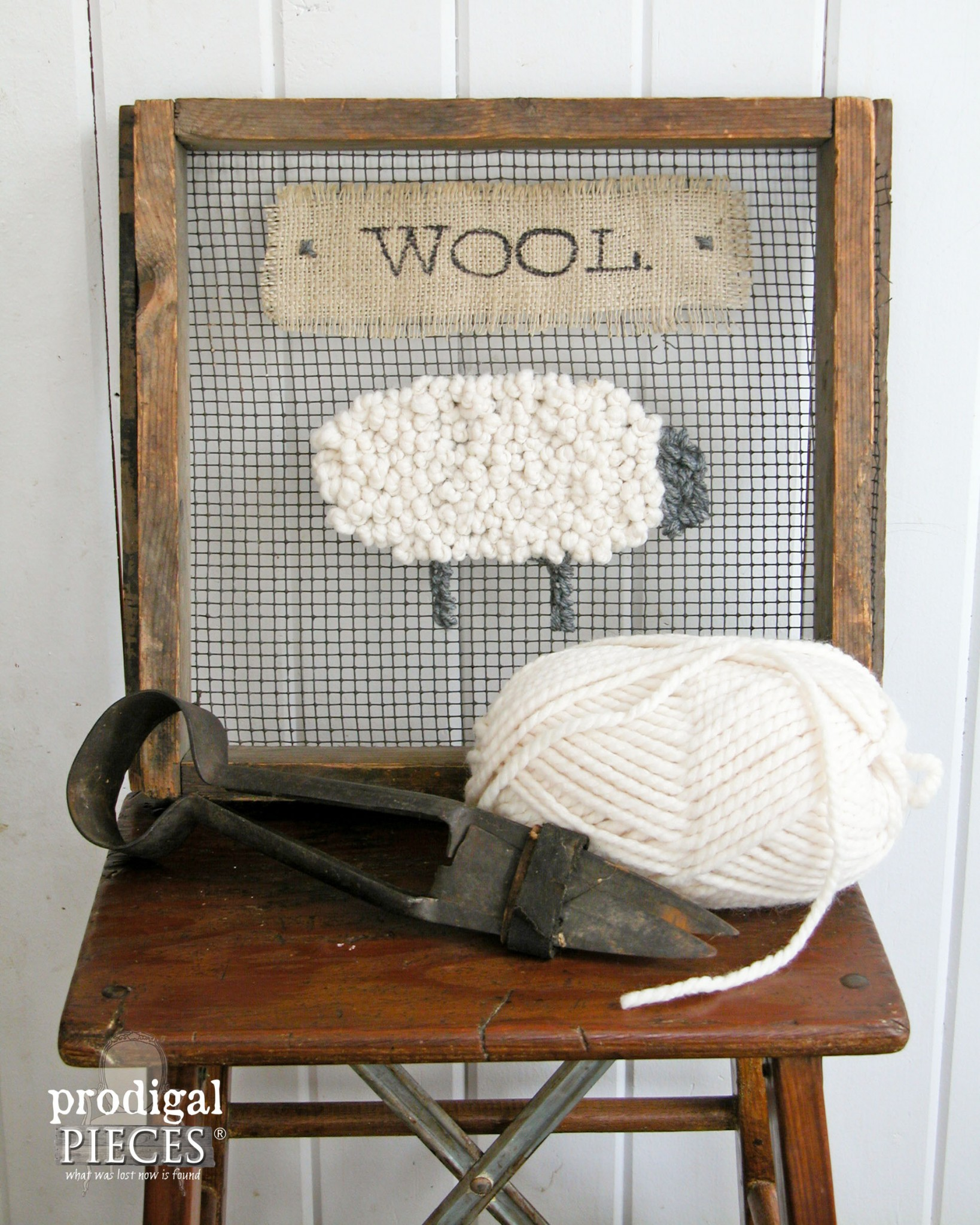 Cross stitch styled picture on a vintage screen, by Prodigal Pieces, featured on Funky Junk Interiors