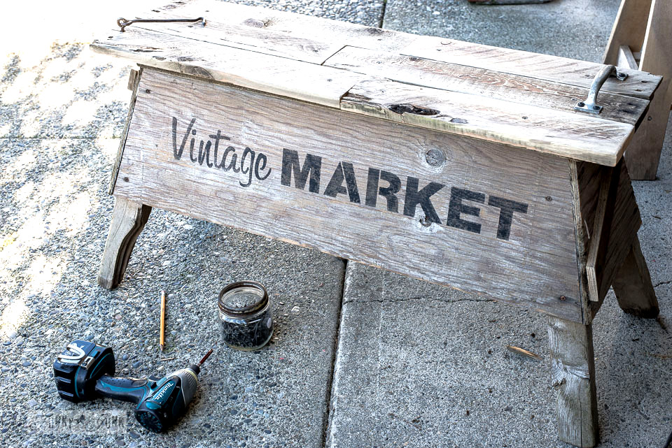 Pallet wood sawhorse coffee table using Vintage Market, part of Funky Junk's Old Sign Stencils