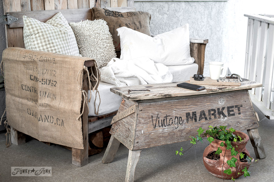 Pallet wood sawhorse coffee table with a pallet wood sofa on a patio / funky junk's old sign stencils