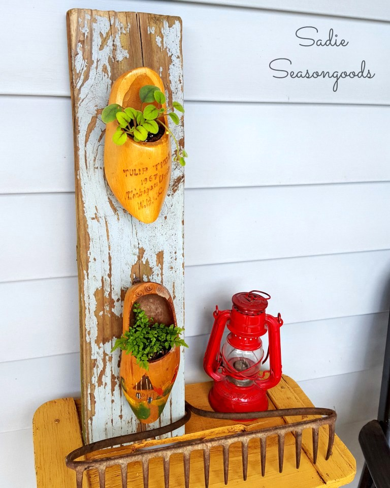 Wooden shoe planters on a reclaimed wood plank, by Sadie Seasongoods, featured on Funky Junk Interiors