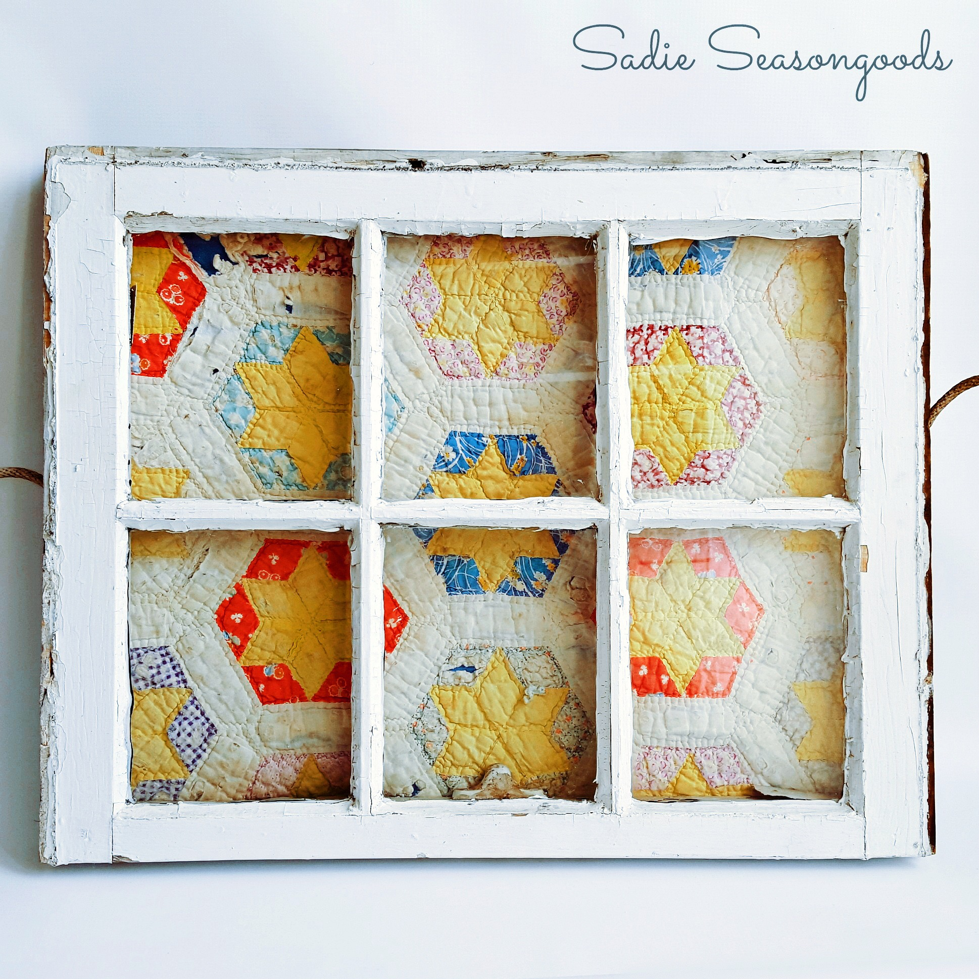 Quilt wall art in an old window, by Sadie Seasongoods, featured on Funky Junk Interiors