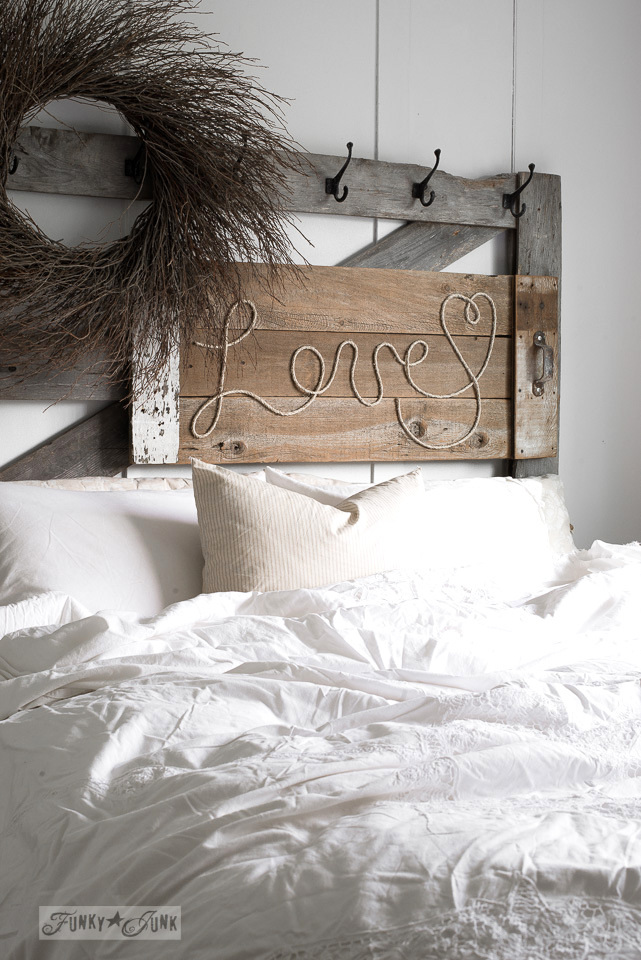 Reclaimed wood LOVE rope sign mounted to an old gate headboard / funkyjunkinteriors.net