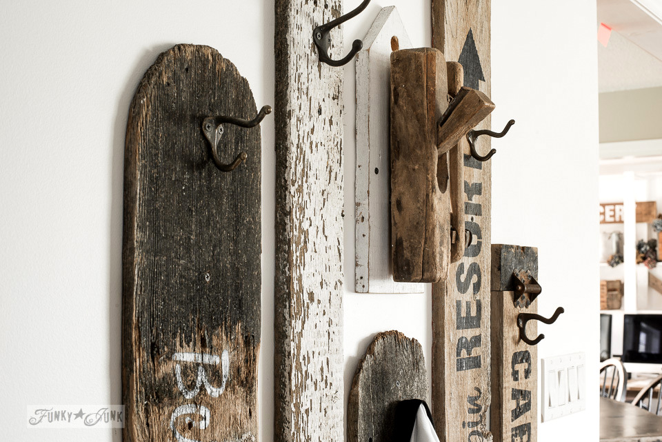 Old signs wall hooks in a hallway, by funkyjunkinteriors.net