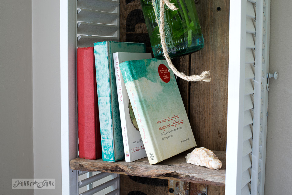 Books on a reclaimed wood shelf - by Mari Kondo and Denise Voccola / funkyjunkinteriors.net