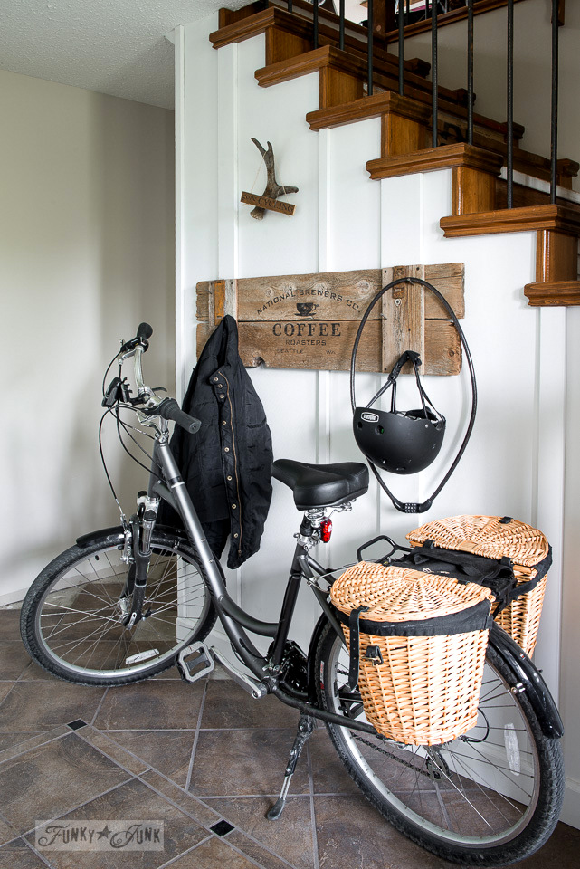bike parked in an entryway with an old sign holding bike gear / funkyjunkinteriors.net