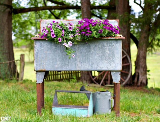 Galvanized wash tub flower planter, by Grit Antiques, featured on Funky Junk Interiors