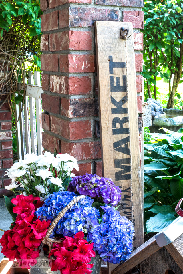 Flower filled antique Baycrest wagon by the front door, decked out with market signs from Funky Junk's Old Sign Stencils / funkyjunkinteriors.net