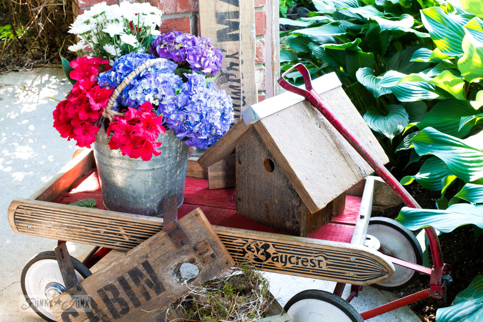Flower filled antique Baycrest wagon by the front door / funkyjunkinteriors.net