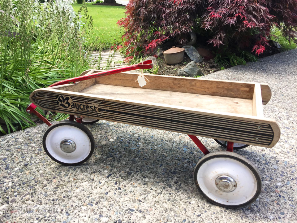 Flower filled Baycrest antique wagon by the front door / funkyjunkinteriors.net