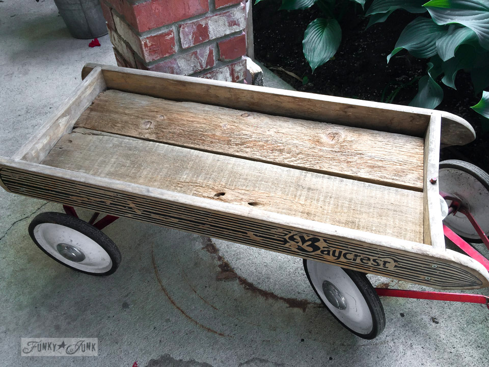 Antique Baycrest wagon lined with reclaimed wood / funkyjunkinteriors.net