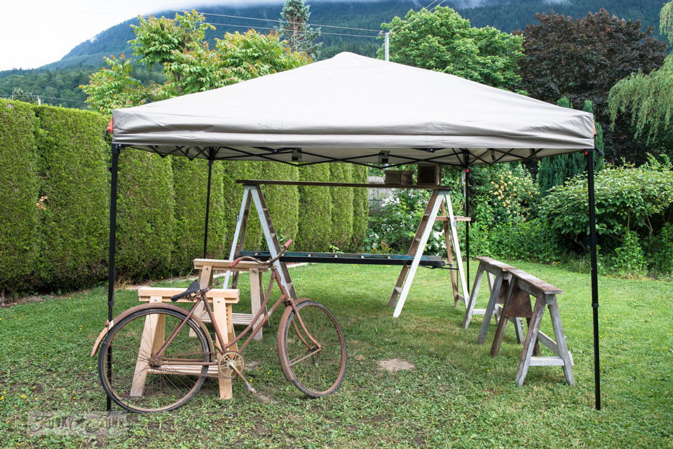 rustic market set up trial in the backyard with a 10 x 10 tent