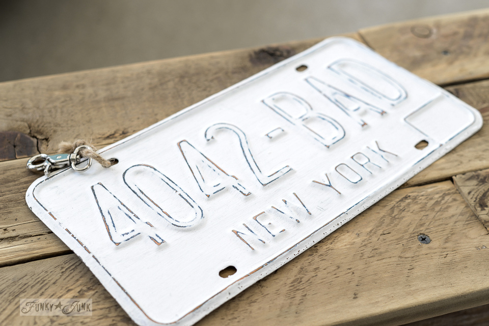 White painted New York license plate souvineer from Susan via Homeroad / funkyjunkinteriors.net