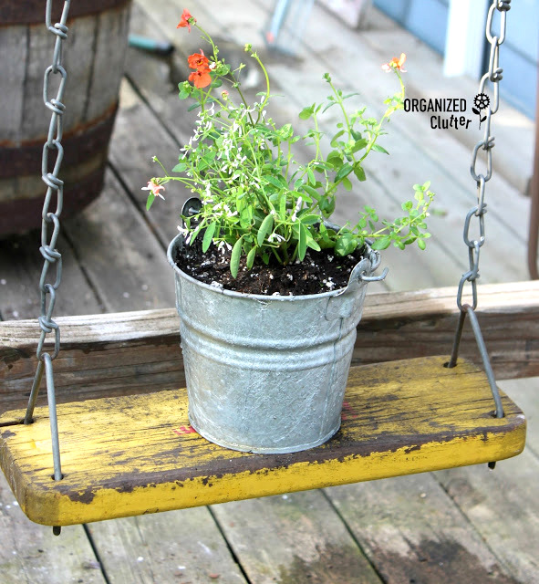 Wooden swing plant holder, by Organized Clutter, featured on Funky Junk Interiors