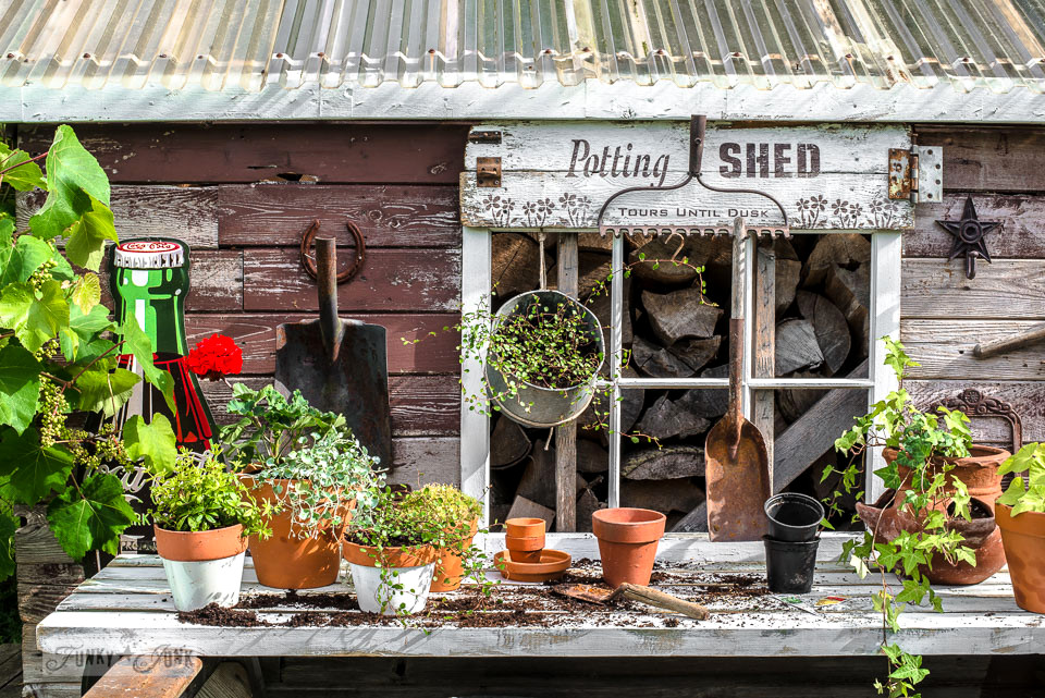 Rustic Shed Reveal With Sawhorse Potting Bench And Old Rake Sign For
