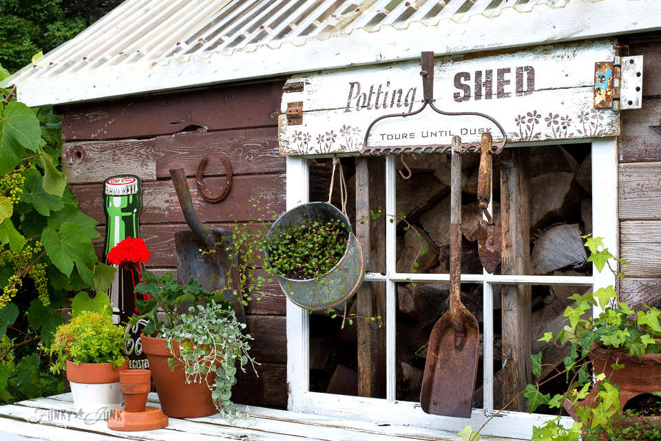 Potting shed sign with an old rake that holds garden tools on a rustic garden shed | made with Funky Junk's Old Sign Stencils & Fusion Mineral Paint | funkyjunkinteriors.net
