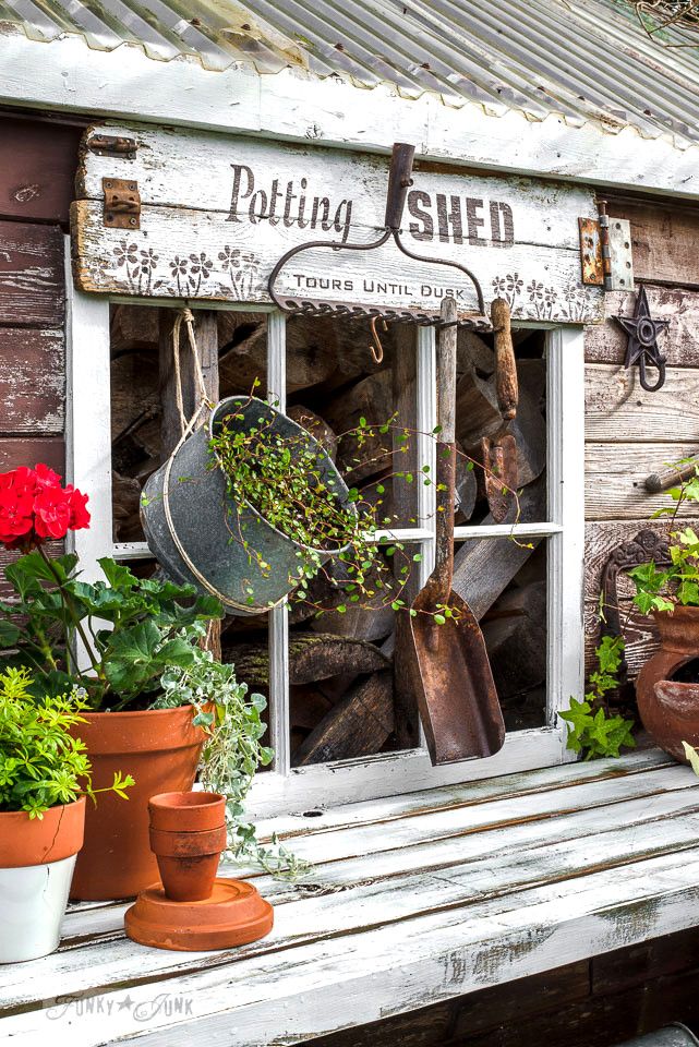 Rustic shed reveal with sawhorse potting bench and old rake sign for garden tools | made with Funky Junk's Old Sign Stencils & Fusion Mineral Paint | funkyjunkinteriors.net