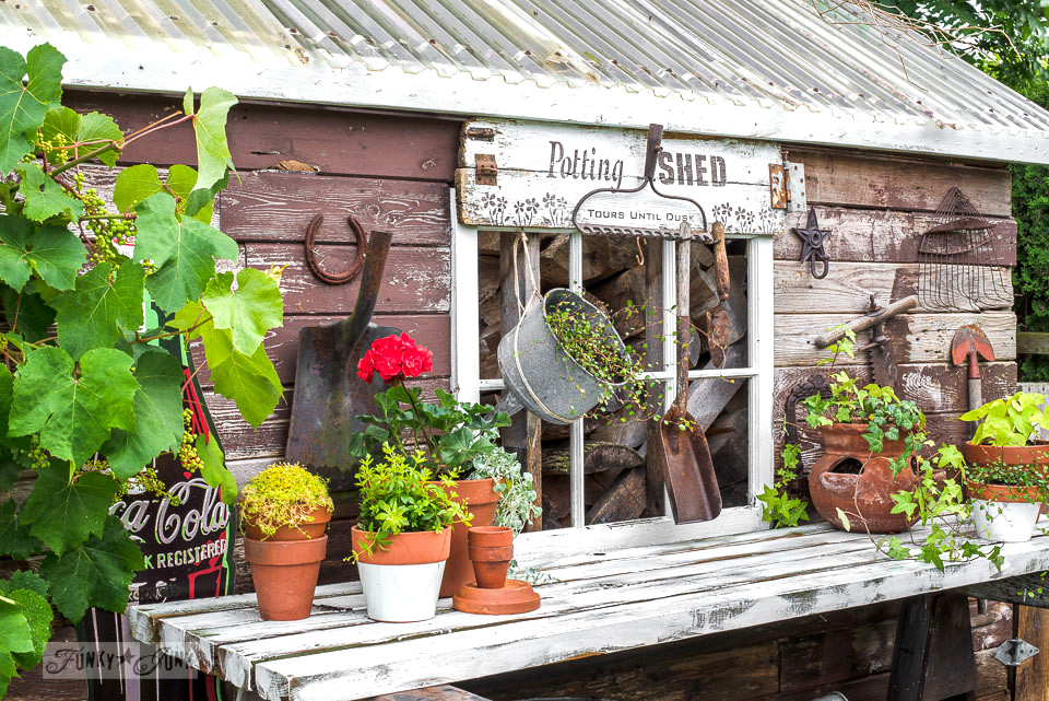 Rustic shed reveal with sawhorse potting bench and old rake sign for rustic shed reveal with sawhorse potting bench and old rake sign for garden tools made workwithnaturefo