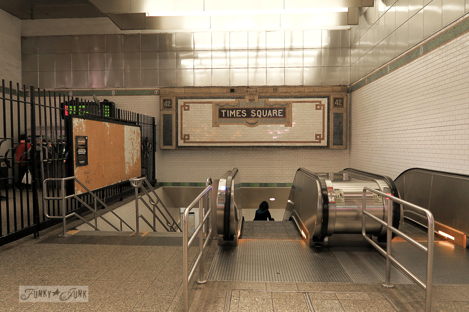 Times Square subway station escalators and historic tile sign, in New York City / funkyjunkinteriors.net