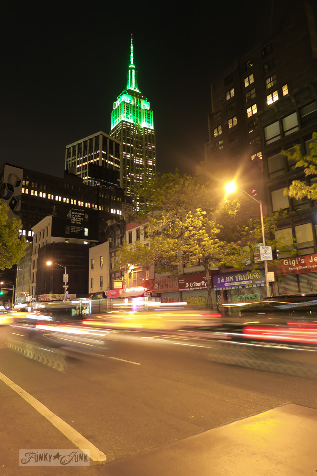 The Empire State Building illuminated at night with fast street car action! | funkyjunkinteriors.net