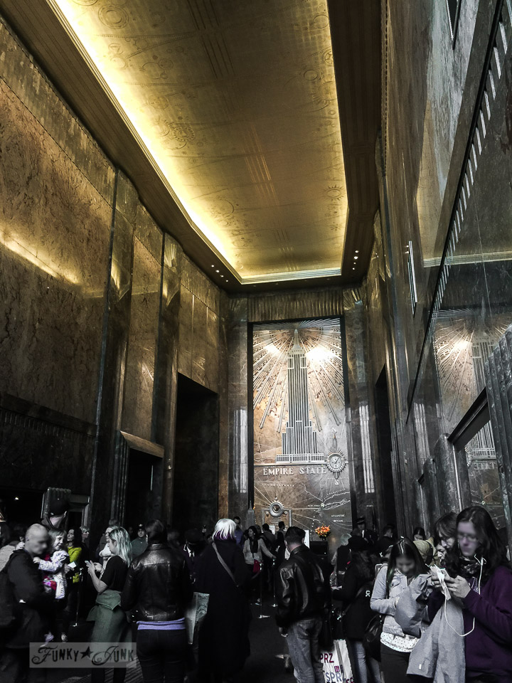 The golden, stately lobby of the Empire State Building in New York City / funkyjunkinteriors.net