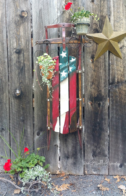 Vintage sleigh Americana planter, by Redo It Yourself Inspirations, featured on Funky Junk Interiors