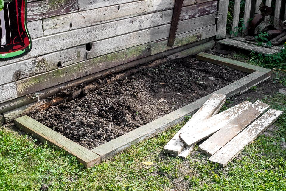 Creating a flowerbed under a potting shed bench / funkyjunkinteriors.net