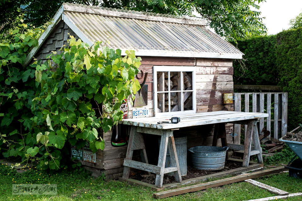 Rustic shed 2 - instant sawhorse potting bench with a flowerbed twist! Come see how it's done! | funkyjunkinteriors.net