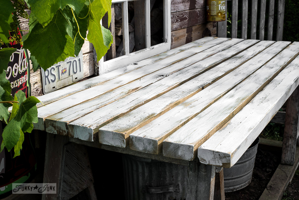 painting the top of treated boards for a potting bench with Fusion Mineral Paint's Casement for a rustic white washed look | funkyjunkinteriors.net