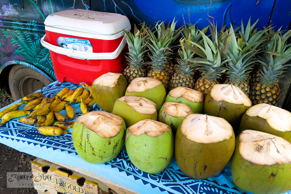 Fruit stand of fresh coconut, pineapple, bananas and treats at Twin Falls, Maui | funkyjunkinteriors.net