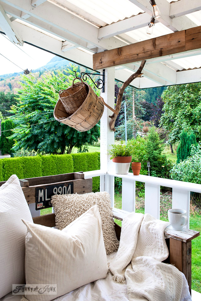 pallet wood chair with rustic baskets and branch corbel on a summer patio | funkyjunkinteriors.net