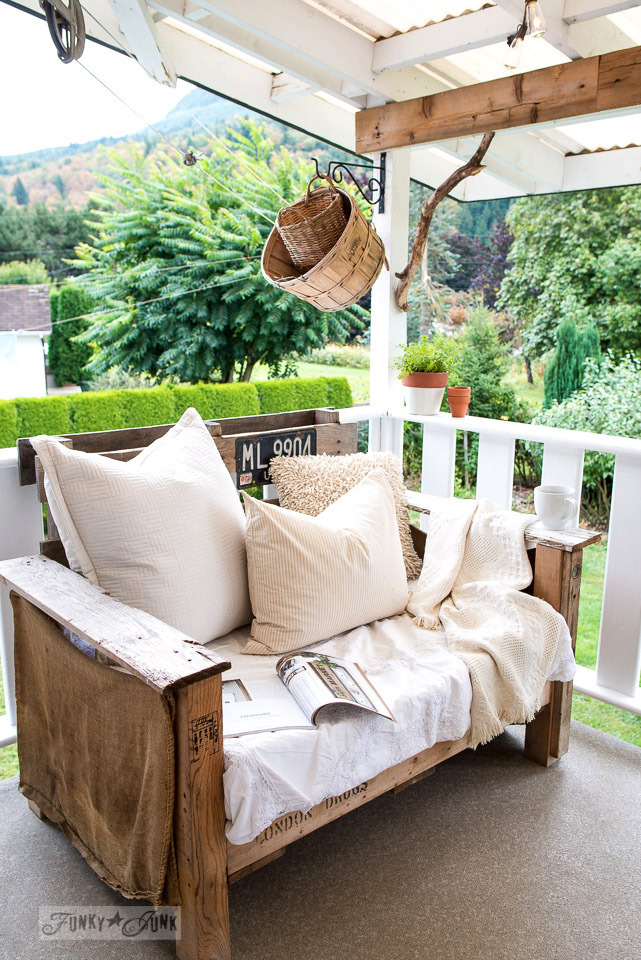 pallet wood chair with rustic baskets and branch corbel on a patio | funkyjunkinteriors.net