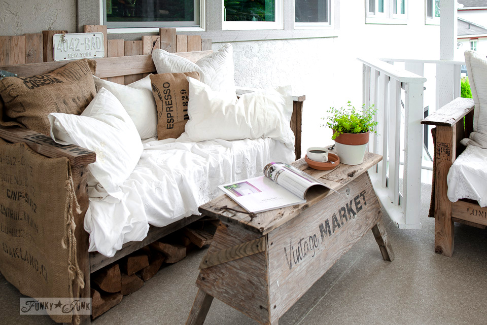 pallet wood sofa with vintage market signed sawhorse coffee table on a summer patio | funkyjunkinteriors.net